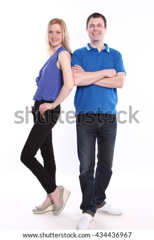 happy young couple on white background - stock photo