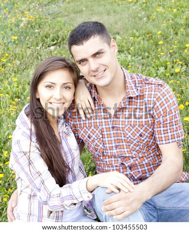 Happy young couple outdoor in spring - stock photo
