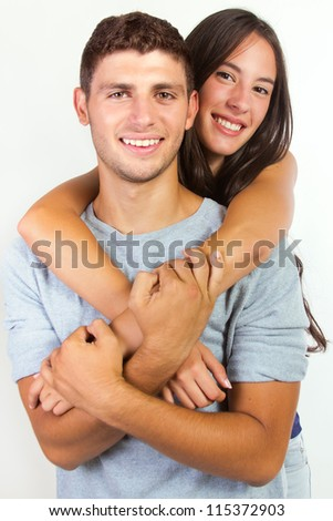 happy young couple posing on white background - stock photo