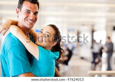 happy young couple reunion at airport - stock photo