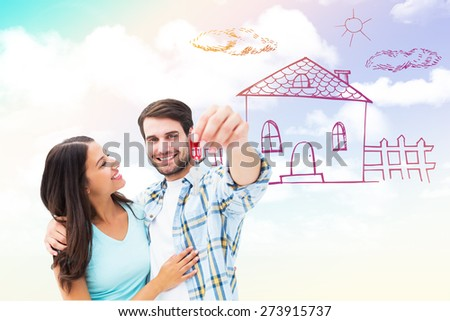 Happy young couple showing new house key against blue sky - stock photo