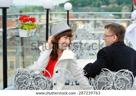 happy young couple sitting at a table in a cafe. - stock photo