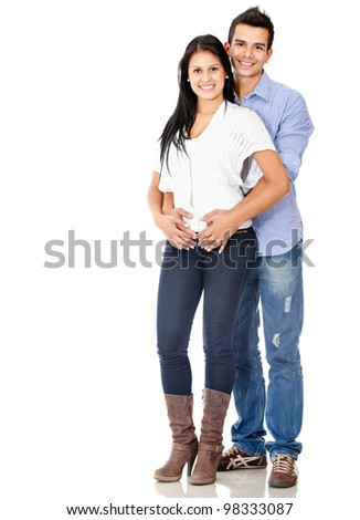 Happy young couple smiling - isolated over a white background - stock photo