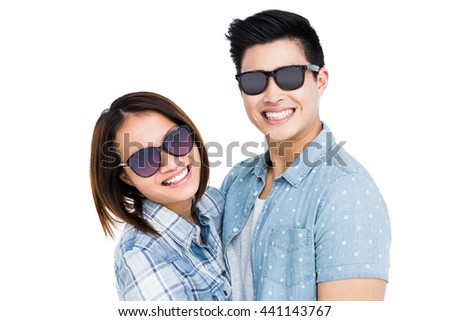 Happy young couple smiling on white background - stock photo
