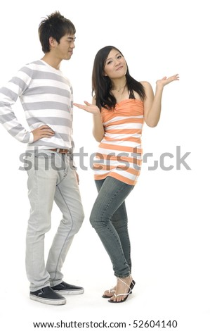 Happy young couple standing together - stock photo