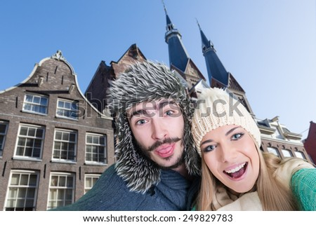 Happy, young couple taking a self portrait photo, selfie, in Amsterdam, Netherlands - stock photo