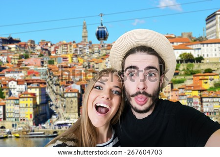 Happy, young couple taking a self portrait photo, selfie, in Porto Portugal. - stock photo