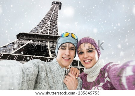 Happy, young couple taking a self portrait photo, selfie, in the front of the Eiffel tower, Paris - stock photo