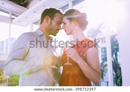 Happy young couple toasting glasses of champagne - stock photo