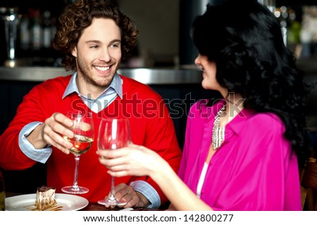 Happy young couple toasting in love, cheers! - stock photo