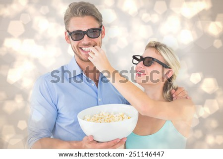 Happy young couple wearing 3d glasses eating popcorn against light glowing dots design pattern - stock photo