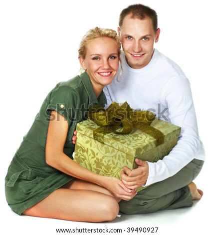 happy young couple with a gift over white - stock photo
