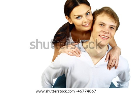 Happy young couple, young man and woman embrace and laugh. Isolated. - stock photo