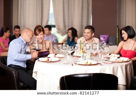 happy young couples talking restaurant table - stock photo