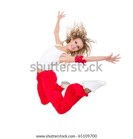 Happy young dancer jumping against isolated white background - stock photo