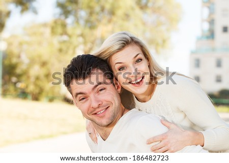 Happy Young disabled man and his girlfriend piggyback - stock photo