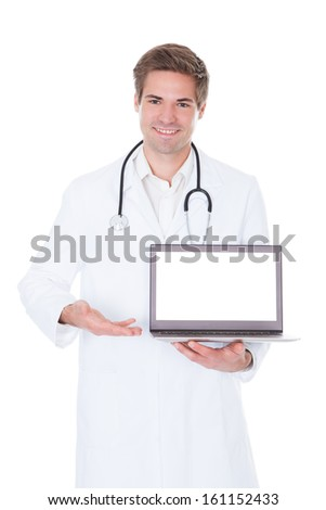 Happy Young Doctor Using Laptop Over White Background - stock photo