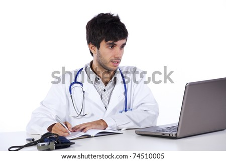 happy young doctor working at his desk (isolated on white) - stock photo