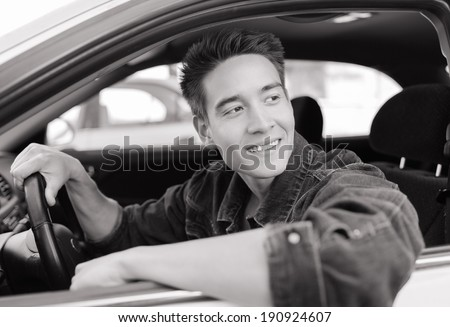 Happy young driver men in the car. - stock photo
