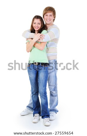 happy young embracing loving couple standing on full-length at photo - stock photo
