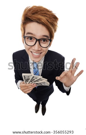 Happy young entrepreneur with money in his hands - stock photo