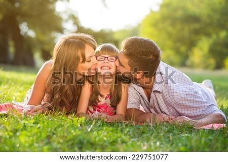 Happy young family enjoy on picnic - stock photo