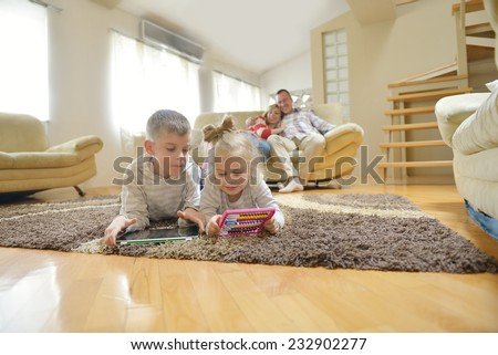 happy young family have fun  with their children at modern living room home indoors - stock photo