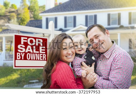 Happy Young Family In Front of For Sale By Owner Real Estate Sign and House. - stock photo
