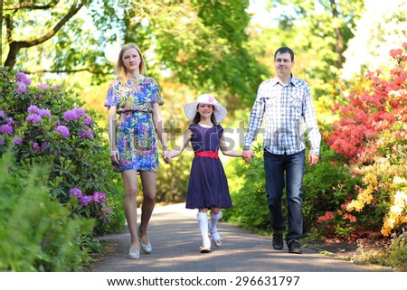 happy young family in park - stock photo