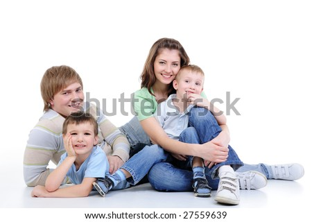 happy young family of four family enjoing together - isolated - stock photo