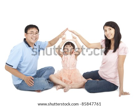 happy young family showing home sign by hands - stock photo
