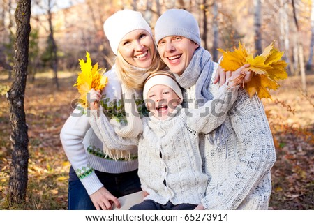 happy young family spending time outdoor in the park - stock photo