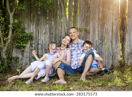 Happy young family spending time together outside in nature. - stock photo
