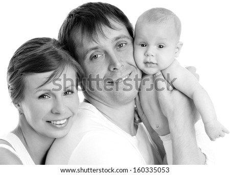 Happy young family with baby. Indoors. - stock photo