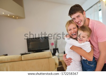happy young family with kids in bright modern living room have fun  - stock photo