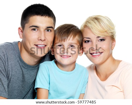 Happy young family with son of 6 years posing over white background - stock photo