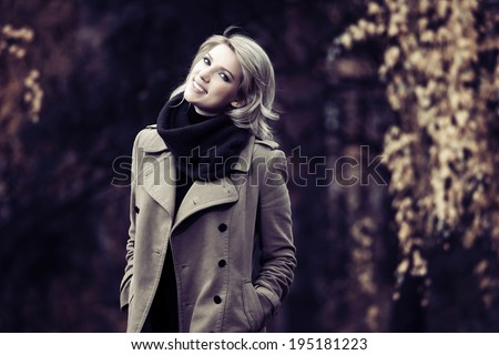 Happy young fashion woman walking in autumn forest  - stock photo