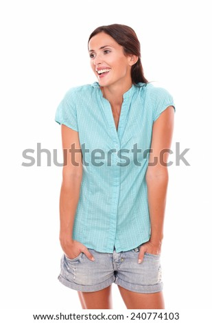 Happy young female looking to her right and smiling in white background - copyspace - stock photo