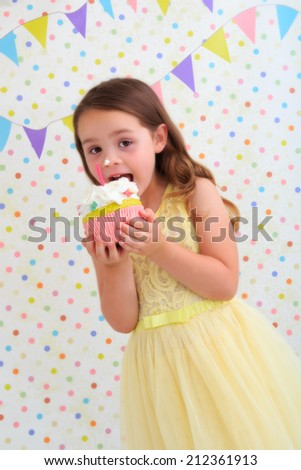 Happy young girl eating cream cake - stock photo