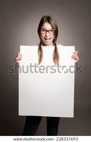happy young girl holding a banner - stock photo