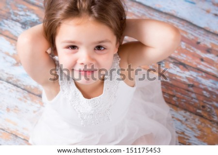 Happy young girl looking at the camera - stock photo