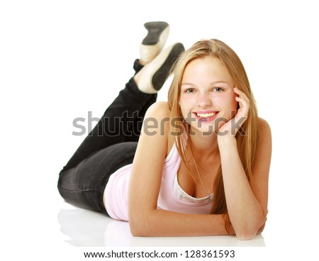 Happy young girl lying on floor, isolated on white background - stock photo