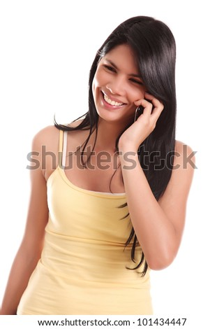 Happy young girl speaking by cell phone, white background - stock photo