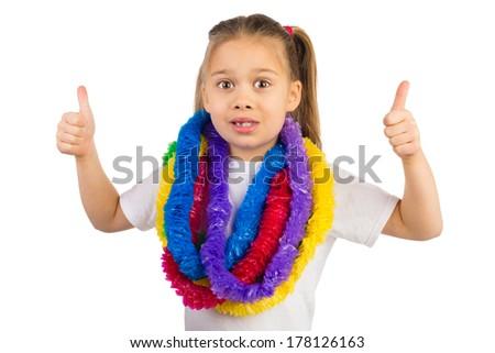 Happy young girl wearing Hawaiian party garland, shows thumbs up - stock photo