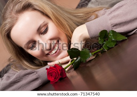 Happy young girl with a flower - stock photo