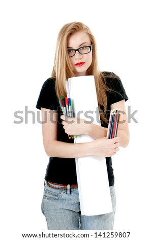 Happy young girl with  colored pencils, felt-tip  and white roll paper, wearing black t-shirt, denim shorts, glasses.  Creativity concept. - stock photo