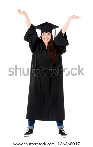 Happy young graduate girl student in mantle, isolated on white background - stock photo