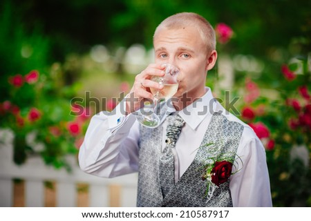Happy young groom on their wedding day. Handsome caucasian man in tuxedo - stock photo