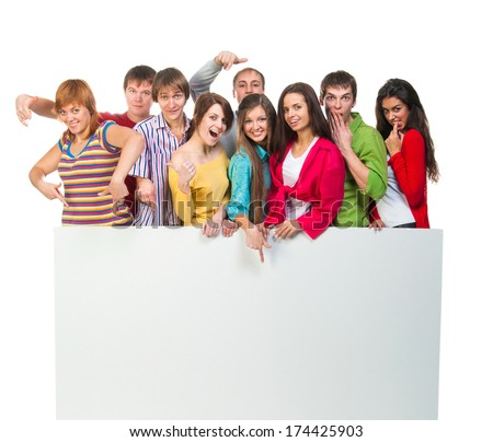 Happy young group of people standing together and holding a blank sign for your text. isolated on white background - stock photo