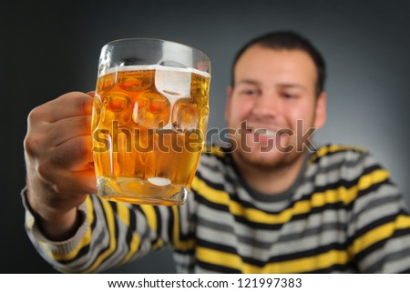 happy young guy drinking beer - stock photo